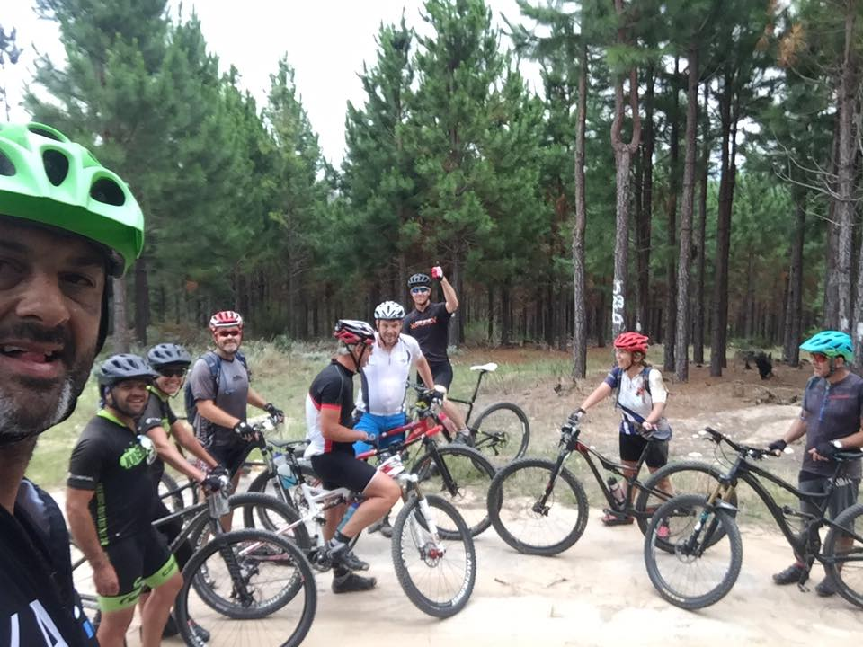riders on forest MTB trails